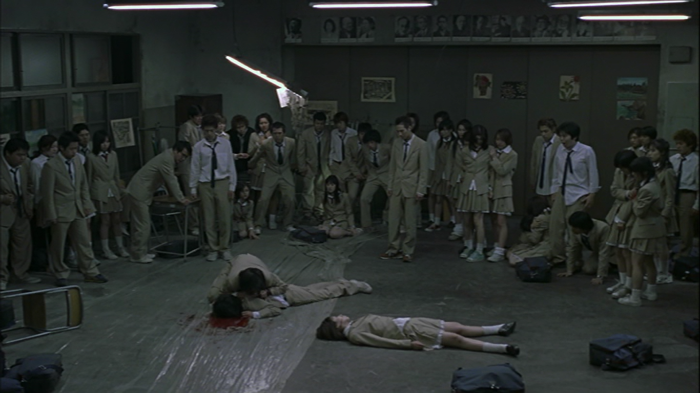 battle royale dan norman sonder magazine kinji fukasaku s storytelling efficiency is clear from the very first scene media rushing to report on the results of the latest battle royale which ends on